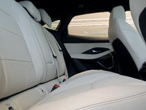 Side view of rear seats in car interior with black and white leather upholstery stock photo