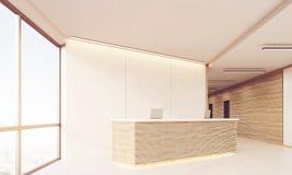 Side view of reception desk in long sunlit corridor Stock Photo