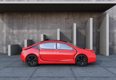 Side view of red autonomous car in front of geometric object background Stock Photo