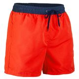 Side view of red and navy blue men shorts for swimming. Isolated on white background royalty free stock photos