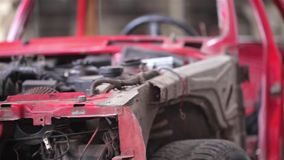 Side view of red old rusty car stock footage