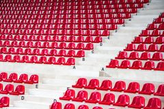 Side view red stadium seats Royalty Free Stock Photography