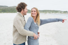 Side view of a relaxed romantic couple at beach Stock Photos
