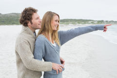 Side view of a relaxed romantic couple at beach Stock Photography