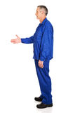 Side view of repairman ready to handshake Stock Photography