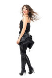 Side view of rock and roll woman turn to camera with frozen hair movement Royalty Free Stock Photography