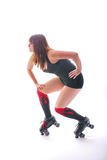 Side view Roller Derby Girl. Female roller derby player on white background Royalty Free Stock Image