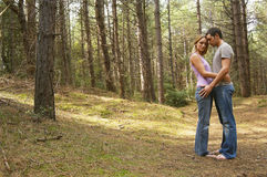 Side View Of Romantic Couple In Forest Royalty Free Stock Photo