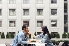Side view. Romantic couple sitting in cafe. stock photography