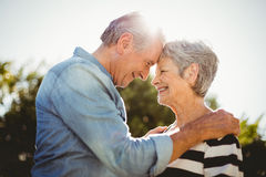 Side view of romantic senior couple looking at each other Stock Images