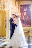 Side view of romantic wedding couple standing in church Royalty Free Stock Photos