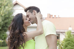 Side view of romantic young couple kissing outdoors Royalty Free Stock Photo