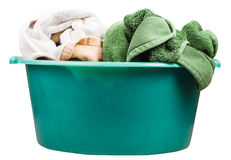 Side view of round green wash basin with towels Royalty Free Stock Images