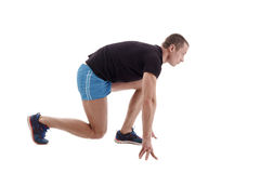 Side view of runner on starting block. Studio photo Stock Photography