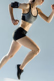 Side view of running sporty woman Stock Image