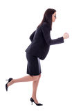 Side view of running young woman in business suit isolated on wh Royalty Free Stock Photography