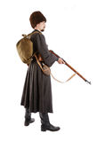 Side view of Russian Cossack with a gun. Stock Image