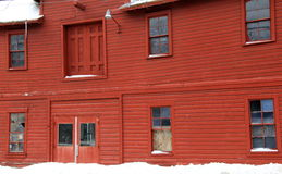 Side view of rustic red barn on snowy day Royalty Free Stock Photography