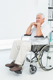 Side view of a sad senior man sitting in wheelchair Royalty Free Stock Photos