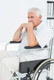 Side view of a sad senior man sitting in wheelchair Royalty Free Stock Photo