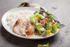 Side view of salad with chicken. Italian salad with rotisserie chicken and white rice side view Royalty Free Stock Images