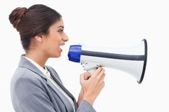 Side view of saleswoman using megaphone Stock Images