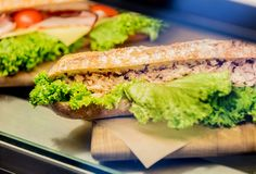 Side view at sandwich snack with salat under glass royalty free stock photo