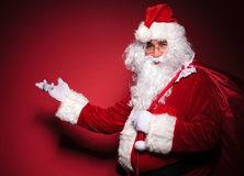 Side view of santa claus presenting Royalty Free Stock Photography