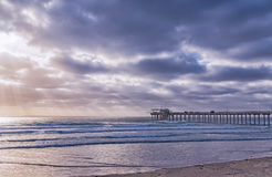 Side view of Scripps Pier at La Jolla, San Diego, California. Background photo of Scripps Pier beach on a cloudy day Royalty Free Stock Image