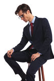 Side view of a seated business man with glasses thinking Stock Photo