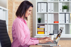 Side view of secretary at workplace Stock Images