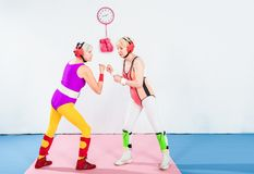 Side view of senior female wrestlers in head protection fighting. Together stock photography