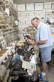 Side view of senior locksmith working in store Stock Image