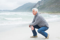 Side view of a senior man relaxing at beach Royalty Free Stock Image