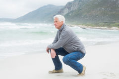 Side view of a senior man relaxing at beach Stock Photo