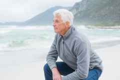 Side view of a senior man relaxing at beach Stock Photography