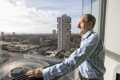 Side view of senior man standing on balcony Royalty Free Stock Photos
