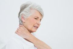 Side view of a senior woman suffering from neck pain Royalty Free Stock Images