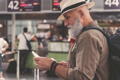Serious bearded retire watching at cheque Royalty Free Stock Photos