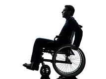 Side view serious handicapped man in wheelchair silhouette. One handicapped man side view serious in silhouette studio on white background royalty free stock photography