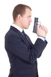 Side view of serious man in business suit with gun isolated on w Royalty Free Stock Photography