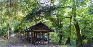 Side view of a shed ready for dining with plastic roof and without walls and the path of access, inside a typical Atlantic forest. In Galicia, Spain royalty free stock photo