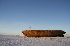 Side view of the shipwreck remains of the Maud, Cambridge Bay Nunavut. Shipwreck remains of the Maud, named for Queen Maud of Norway, a ship built for Roald Stock Photo