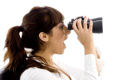 Side view of shocked female viewing through Royalty Free Stock Images