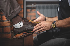 Side view of shoe shine process Stock Images