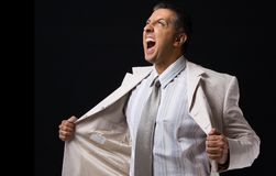 Side view of shouting boss holding his coat Royalty Free Stock Images