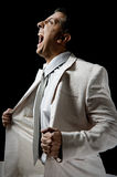 Side view of shouting ceo holding his coat Stock Image