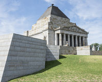 Side View of Shrine of Remembrance, Melbourne, Australia. A side view of the Shrine of Remembrance with a concrete brick wall of the visitors centre in the Stock Photo