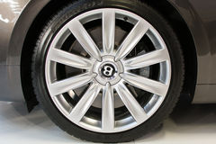 Side view of silver Bentley alloy wheel Stock Photography