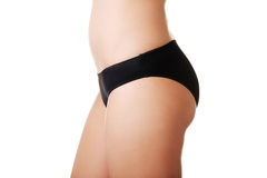 Side view of slim woman buttocks in lingerie Royalty Free Stock Photo